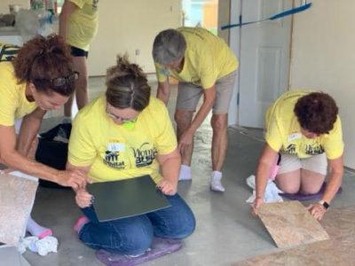 Estero Island Chicks laying floors for Habitat for Humanity