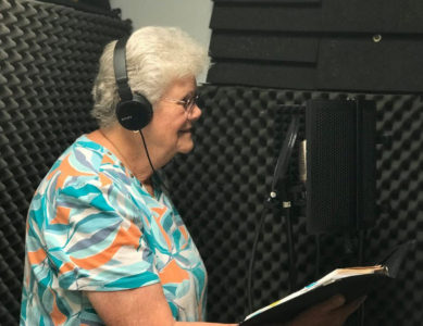 Chaplain Lynne Holden records the voiceover for our Memorial Day video.